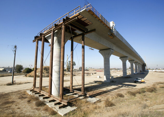 FILE - This Dec. 6, 2017, file photo shows one of the elevated sections of the high-speed rail under construction in Fresno, Calif. California Gov. Gavin Newsom on Friday, May 14, 2021, proposed spending $11 billion on transportation improvements, half of it for a troubled bullet train intended to eventually link California's major metropolitan areas and for projects supporting the 2028 Summer Olympics in Los Angeles. (AP Photo/Rich Pedroncelli, File)