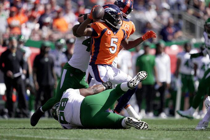 New York Jets defensive tackle Sheldon Rankins tackles Denver Broncos quarterback Teddy Bridgewater (5) during the first half of an NFL football game Sunday, Sept. 26, 2021, in Denver. (AP Photo/Jack Dempsey)