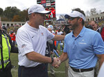 Virginia head coach Bronco Mendenhall, left, shakes North Carolina head coach Larry Fedora's hand after Virginia's win in their NCAA college football game on Saturday, Oct. 27, 2018, in Charlottesville, Va. Virginia beat North Carolina 31-21. (Zack Wajsgras /The Daily Progress via AP)