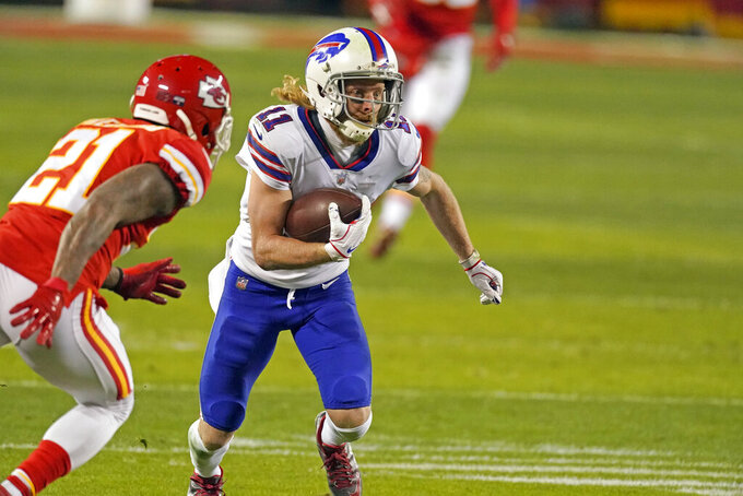 Buffalo Bills wide receiver Cole Beasley (11) runs from Kansas City Chiefs cornerback Bashaud Breeland (21) after catching a pass during the second half of the AFC championship NFL football game, Sunday, Jan. 24, 2021, in Kansas City, Mo. (AP Photo/Charlie Riedel)