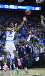 North Carolina's Coby White (2) shoots as Auburn's Jared Harper (1) defends during the second half of a men's NCAA tournament college basketball Midwest Regional semifinal game Friday, March 29, 2019, in Kansas City, Mo. (AP Photo/Orlin Wagner)