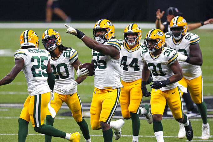 Green Bay Packers outside linebacker Za'Darius Smith (55)c elaborates his fumble recovery in the second half of an NFL football game against the New Orleans Saints in New Orleans, Sunday, Sept. 27, 2020. (AP Photo/Brett Duke)