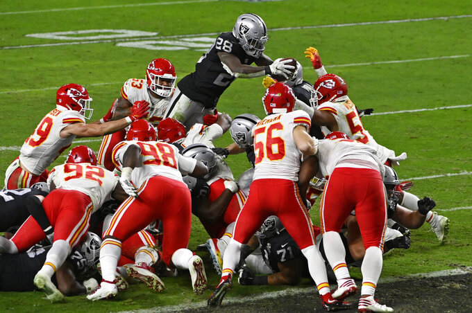 Las Vegas Raiders running back Josh Jacobs (28) dives into the air for an unsuccessful attempt at a touchdown against the Kansas City Chiefs during the second half of an NFL football game, Sunday, Nov. 22, 2020, in Las Vegas. (AP Photo/David Becker)