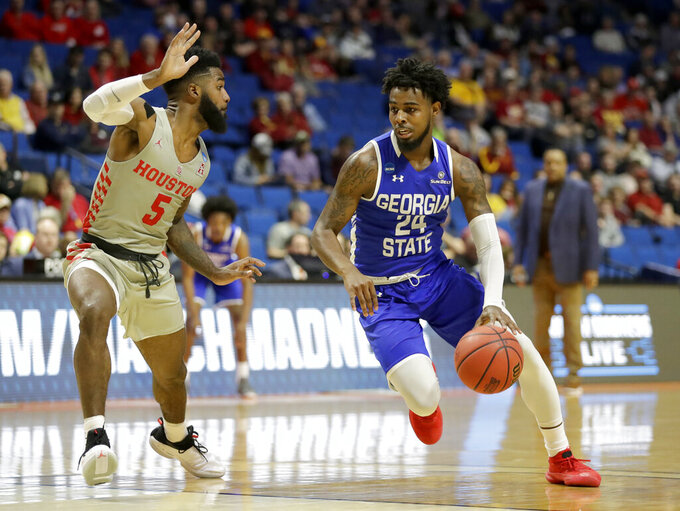 Georgia State's Devin Mitchell (24) heads to the basket past Houston's Corey Davis Jr. (5) during the first half of a first round men's college basketball game in the NCAA Tournament Friday, March 22, 2019, in Tulsa, Okla. (AP Photo/Jeff Roberson)