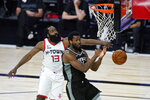Houston Rockets' James Harden (13) blocks a shot by Sacramento Kings' Harrison Barnes (40) during the second half of an NBA basketball game Sunday, Aug. 9, 2020, in Lake Buena Vista, Fla. (AP Photo/Ashley Landis, Pool)