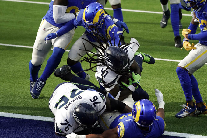 Seattle Seahawks running back Alex Collins (41) lunges into the end zone for a touchdown during the first half of an NFL football game against the Los Angeles Rams Sunday, Nov. 15, 2020, in Inglewood, Calif. (AP Photo/Jae C. Hong)