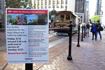 A sign on California Street alerts riders of an upcoming cable car shut down Wednesday, Sept. 11, 2019, in San Francisco. San Francisco's iconic cable cars will stop running for 10 days starting Friday to undergo repairs. The city's transit agency says it needs to get the manually operated cable cars off the street to rehabilitate the gearboxes that power the system that started in the 1890s. Shuttle buses will instead transport people along the steep streets of the cable car routes. (AP Photo/Eric Risberg)