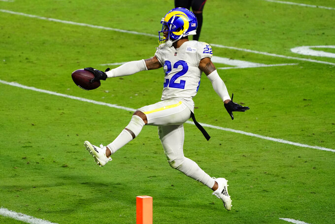 Los Angeles Rams cornerback Troy Hill (22) runs in an interception for a touchdown against the Arizona Cardinals during the second half of an NFL football game, Sunday, Dec. 6, 2020, in Glendale, Ariz. The Rams won 38-28. (AP Photo/Rick Scuteri)