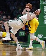 Boston Celtics forward Gordon Hayward, left, looks down court as he grabs a rebound against Indiana Pacers forward Domantas Sabonis, rear, during the first quarter of an NBA basketball game in Boston, Wednesday, Jan. 9, 2019. (AP Photo/Charles Krupa)