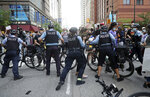 Protesters attempt to break through a police barrier during a march to bring attention to the death of George Floyd in the Loop Friday, May 29, 2020, in Chicago.  Floyd died after being restrained by Minneapolis police officers on Memorial Day.   (John J. Kim/Chicago Tribune via AP)