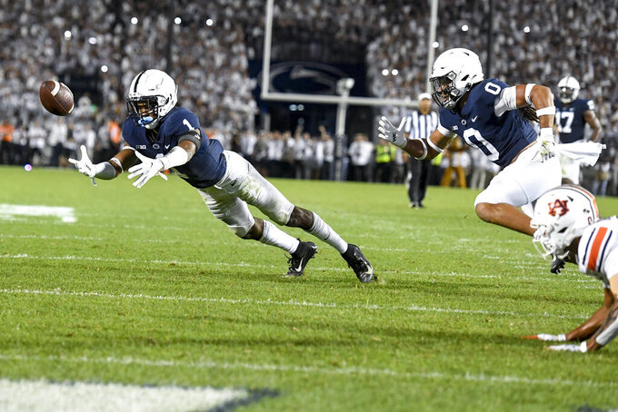 Penn State safety Jaquan Brisker (1) attempts to intercept a pass intended for Auburn wide receiver Demetris Robertson (0) on the final play of their NCAA college football game in State College, Pa., on Saturday, Sept. 18, 2021. Penn State defeated Auburn 28-20. (AP Photo/Barry Reeger)