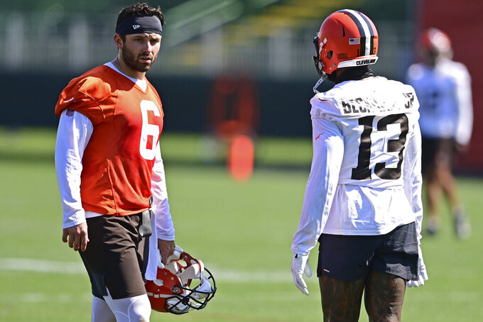 Cleveland Browns quarterback Baker Mayfield, left, talks with Odell Beckham Jr. during an NFL football practice in Berea, Ohio, Tuesday, Aug. 24, 2021. (AP Photo/David Dermer)
