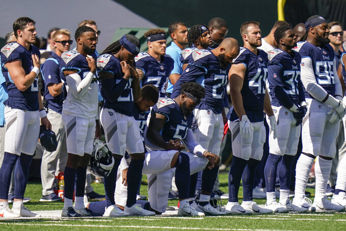 Tennessee Titans linebacker David Long (51) kneels as the national anthem is played before an NFL football game against the New York Jets, Sunday, Oct. 3, 2021, in East Rutherford, N.J. (AP Photo/Seth Wenig)