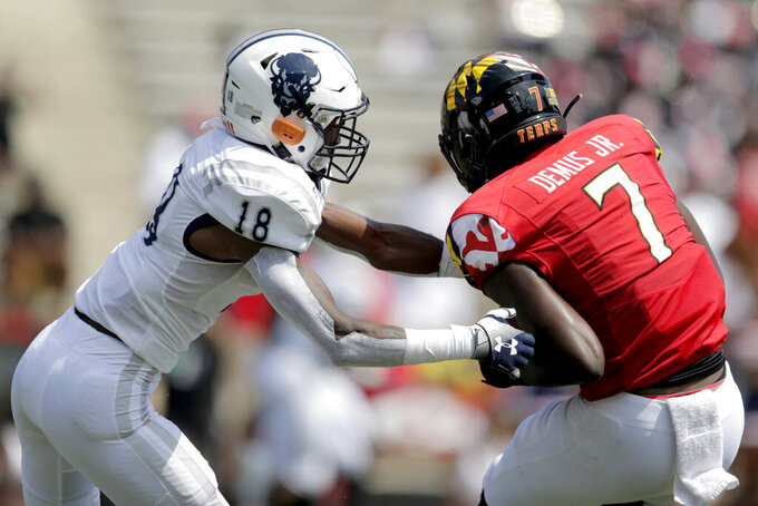 Maryland wide receiver Dontay Demus Jr. (7) catches a touchdown pass from quarterback Josh Jackson as Howard defensive back Jalen Smith defends during the first half of an NCAA college football game, Saturday, Aug. 31, 2019, in College Park, Md. (AP Photo/Julio Cortez)