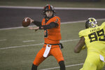 Oregon State quarterback Tristan Gebbia looks for a receiver during the first half of the team's NCAA college football game against Oregon in Corvallis, Ore., Friday, Nov. 27, 2020. (AP Photo/Amanda Loman)