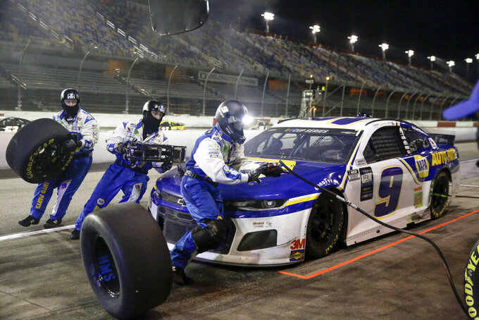 Chase Elliott makes a pit stop during the NASCAR Cup Series auto race Wednesday, May 20, 2020, in Darlington, S.C. (AP Photo/Brynn Anderson)