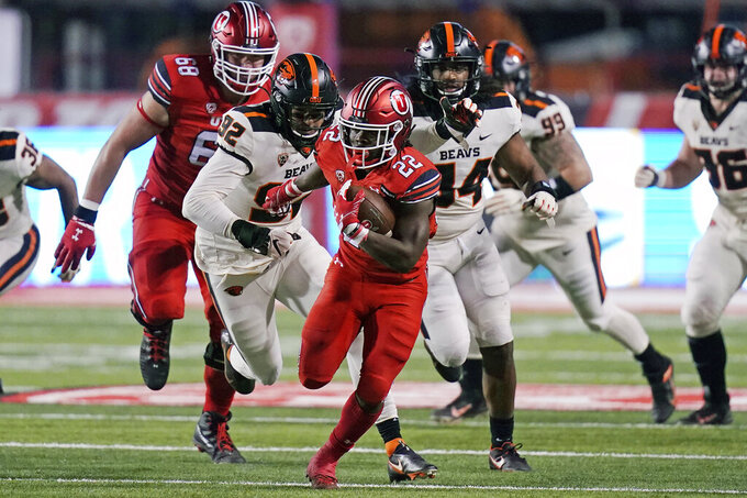 Utah running back Ty Jordan (22) carries the ball against Oregon State during the first half of an NCAA college football game Saturday, Dec. 5, 2020, in Salt Lake City. (AP Photo/Rick Bowmer)