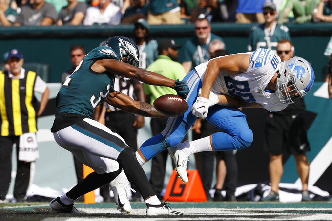 Detroit Lions' T.J. Hockenson, right, cannot catch a pass against Philadelphia Eagles' Rasul Douglas, left, during the second half of an NFL football game Sunday, Sept. 22, 2019, in Philadelphia. (AP Photo/Michael Perez)
