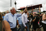 Democratic presidential candidate Sen. Bernie Sanders, I-Vt., tours the Iowa State Fair, Sunday, Aug. 11, 2019, in Des Moines, Iowa. (AP Photo/John Locher)