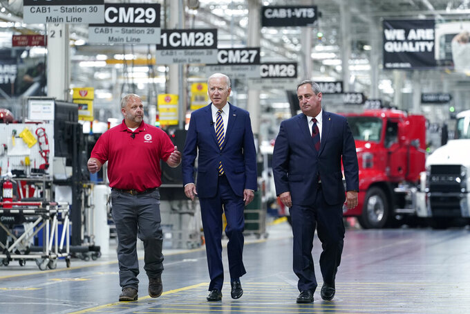 President Joe Biden walks with Mack Trucks President Martin Weissburg, right, and UAW Local 677 Shop Chairman Kevin Fronheiser, left, during a tour of the Lehigh Valley operations facility for Mack Trucks in Macungie, Pa., Wednesday, July 28, 2021. During his visit, he will advocate for government investments and clean energy as ways to strengthen U.S. manufacturing. (AP Photo/Susan Walsh)