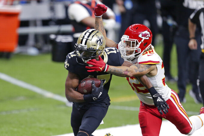 Kansas City Chiefs strong safety Tyrann Mathieu (32) tackles New Orleans Saints wide receiver Emmanuel Sanders (17) on a 51-yard pass play in the first half of an NFL football game in New Orleans, Sunday, Dec. 20, 2020. (AP Photo/Butch Dill)