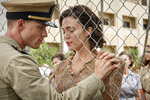 This image released by Lionsgate shows Ed Skrein, left, and Mandy Moore in a scene from