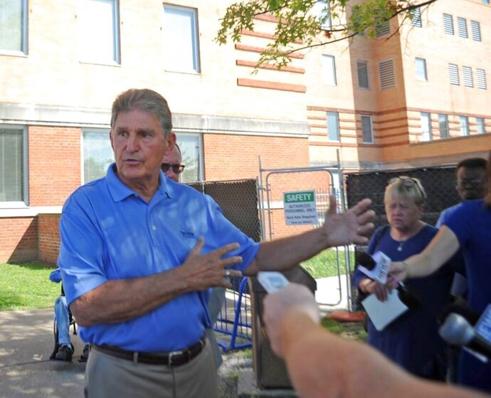 FILE - In this Aug. 30, 2019, file photo, U.S. Sen. Joe Manchin talks to reporters outside of the Louis A. Johnson VA Medical Center in Clarksburg, W.Va. Manchin had called for an expedited investigation into up to 11 suspicious deaths at the hospital. An attorney for one of the men who died said he has filed a notice that he plans to sue over the death. (Eddie Trizzino/Times-West Virginian via AP)