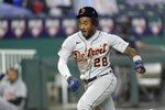 Detroit Tigers' Niko Goodrum runs home to score on a sacrifice fly by Eric Haase during the seventh inning of the team's baseball game against the Kansas City Royals on Friday, Sept. 25, 2020, in Kansas City, Mo. (AP Photo/Charlie Riedel)