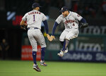 Houston Astros' Carlos Correa, left, and George Springer celebrate the team's 2-0 win over the Los Angeles Angels in a baseball game Wednesday, May 16, 2018, in Anaheim, Calif. (AP Photo/Jae C. Hong)