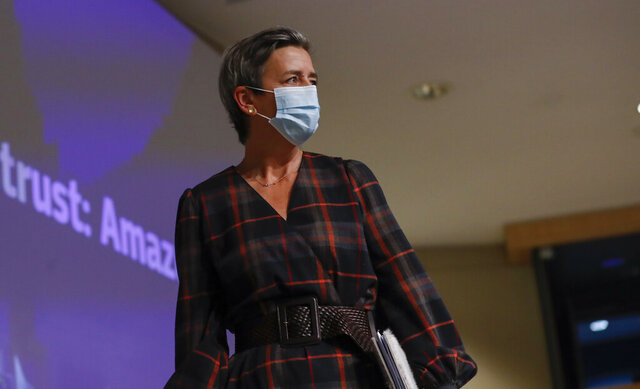 European Executive Vice-President Margrethe Vestager wears a protective face mask after addressing a press conference regarding an antitrust case with Amazon at EU headquarters in Brussels, Tuesday, Nov. 10, 2020. (Olivier Hoslet, Pool via AP)