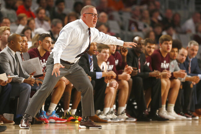 FILE - In this Dec. 8, 2019, file photo, Texas A&M coach Buzz Williams calls a play as Texas A&M played Texas during the second half of an NCAA college basketball game in Fort Worth, Texas. As Williams enters Year 2 at Texas A&M, the former Virginia Tech coach knows that most outside his program aren't expecting much from the Aggies this year--and he isn't the least bit concerned about it. (AP Photo/Ron Jenkins, File)
