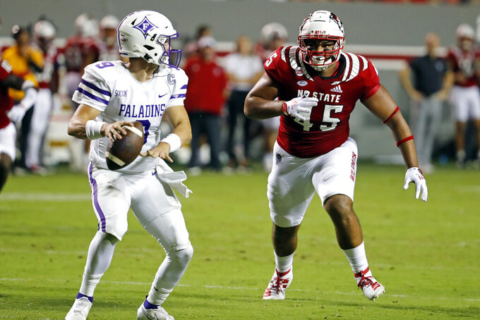North Carolina State's Davin Vann (45) closes in on Furman's Hamp Sisson (9) during the second half of an NCAA college football game in Raleigh, N.C., Saturday, Sept. 18, 2021. (AP Photo/Karl B DeBlaker)