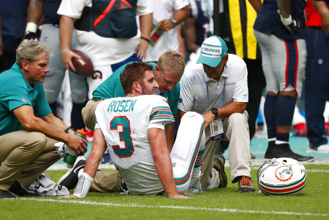 Miami Dolphins quarterback Josh Rosen (3) is assisted on the field, during the second half at an NFL football game against the Miami Dolphins, Sunday, Sept. 15, 2019, in Miami Gardens, Fla. (AP Photo/Wilfredo Lee)