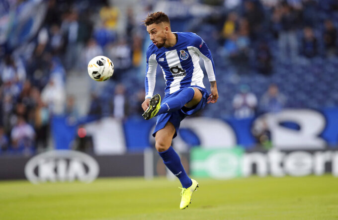 FILE - In this Thursday, Oct. 24, 2020 file photo, Porto's Alex Telles controls the ball during the Europa League group G soccer match between FC Porto and Rangers FC at the Dragao stadium in Porto, Portugal. Manchester United bolstered its defensive options by signing left back Alex Telles on the final day of the summer transfer window in the wake of a 6-1 loss to Tottenham. United already agreed to a deal with Porto ahead of Sunday's humiliation but it was completed on Monday, Oct. 5, 2020 at a cost of 15 million euros ($18 million) plus potentially another 2 million euros depending on the 27-year-old Brazilian's success with the club. (AP Photo/Luis Vieira, File)