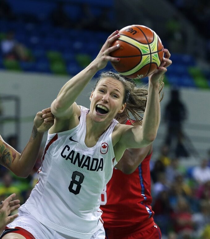 FILE - Canada guard Kim Gaucher pulls down a rebound during the first half of a women's basketball game against the United States at the 2016 Summer Olympics in Rio de Janeiro, Brazil, in this Friday, Aug. 12, 2016, file photo. Canadian basketball player Kim Gaucher, who is breastfeeding her infant daughter, has won in her quest to bring the baby to the Tokyo Olympics. The International Olympic Committee says nursing mothers will now be allowed to bring their babies to Tokyo. (AP Photo/Carlos Osorio, File)