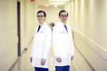 Matthew Mercuri MD, left, and John J. Mercuri, MD pose for a photo at Geisinger Community Medical Center in Scranton on Monday, Dec. 9, 2019. Other than their chosen specialties — John Mercuri is an orthopedic surgeon and Matt Mercuri is a neurologist — they charted near identical career paths, including their return to Northeast Pennsylvania to practice and settle down. (Jake Danna Stevens/The Times-Tribune via AP)