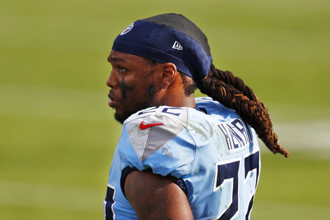 FILE - In this Dec. 6, 2020, file photo, Tennessee Titans running back Derrick Henry watches from the sideline during the first half of the team's NFL football game against the Cleveland Browns in Nashville, Tenn. For several NFL stars, including Henry, speaking out against social injustice meant speaking to youngsters about racism. (AP Photo/Wade Payne, File)