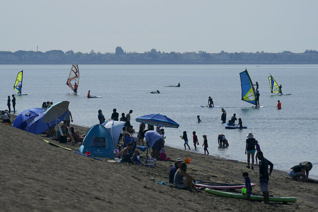 People visit Robert W. Crown Memorial State Beach during the coronavirus outbreak in Alameda, Calif., Saturday, Sept. 5, 2020. (AP Photo/Jeff Chiu)