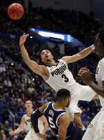 Purdue's Carsen Edwards (3) drives and is fouled by Villanova's Phil Booth (5) during the first half of a second round men's college basketball game in the NCAA Tournament, Saturday, March 23, 2019, in Hartford, Conn. (AP Photo/Elise Amendola)