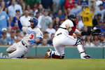 Los Angeles Dodgers' Chris Taylor (3) scores behind Boston Red Sox's Sandy Leon on a single by A.J. Pollock during the first inning of a baseball game in Boston, Saturday, July 13, 2019. (AP Photo/Michael Dwyer)
