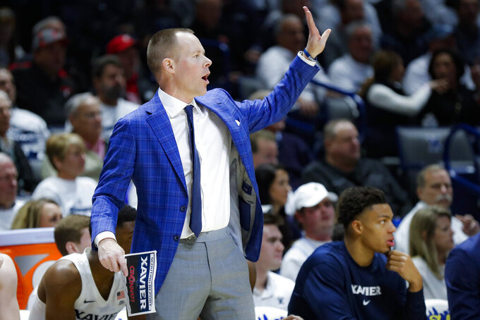 Xavier head coach Travis Steele directs his players from the bench during the second half of an NCAA college basketball game against Cincinnati, Saturday, Dec. 7, 2019, in Cincinnati. (AP Photo/John Minchillo)