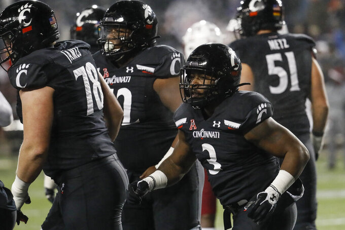 Cincinnati running back Michael Warren II (3) celebrates his touchdown during the second half of an NCAA college football game against Temple, Saturday, Nov. 23, 2019, in Cincinnati. (AP Photo/John Minchillo)