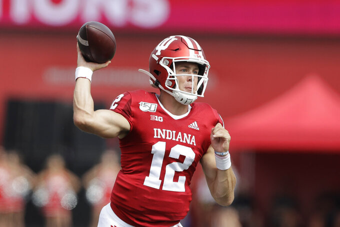 Indiana quarterback Peyton Ramsey (12) throws during the first half of an NCAA college football game against Connecticut, Saturday, Sept. 21, 2019, in Bloomington, Ind. (AP Photo/Darron Cummings)
