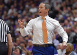 Florida coach Mike White shouts instructions to his players during the first half of an NCAA college basketball game against LSU on Wednesday, Feb. 20, 2019, in Baton Rouge, La. (AP Photo/Bill Feig)