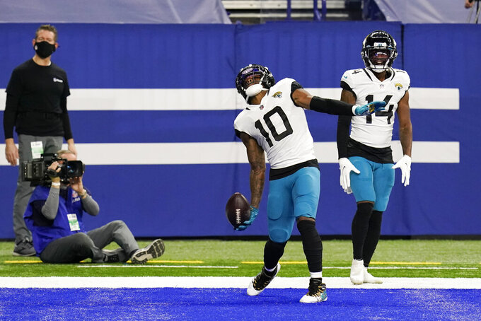 Jacksonville Jaguars' Laviska Shenault Jr. (10 celebrates a touchdown catch during the second half of an NFL football game against the Indianapolis Colts, Sunday, Jan. 3, 2021, in Indianapolis. (AP Photo/Michael Conroy)