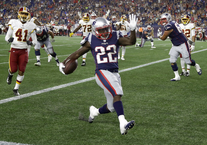 New England Patriots running back Ralph Webb (22) scores a touchdown against the Washington Redskins during the second half of a preseason NFL football game, Thursday, Aug. 9, 2018, in Foxborough, Mass. (AP Photo/Charles Krupa)