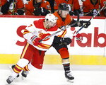 Anaheim Ducks' Nicolas Deslauriers, right, battles with Calgary Flames' TJ Brodie during second period NHL hockey action in Calgary, Alberta, Monday, Feb. 17, 2020. (Larry MacDougal/The Canadian Press via AP)