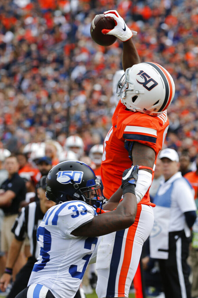 Virginia wide receiver Hasise Dubois (8) grabs a pass near the end zone as Duke cornerback Leonard Johnson (33) defends during the first half of an NCAA college football game in Charlottesville, Va., Saturday, Oct. 19, 2019. Dubois stepped out of bounds on the play but Johnson was called for a foul. (AP Photo/Steve Helber)