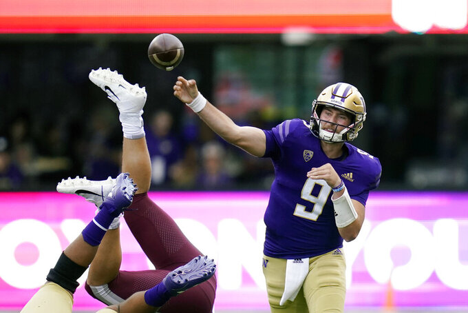Washington's Dylan Morris (9) passes against Montana in the first half of an NCAA college football game Saturday, Sept. 4, 2021, in Seattle. (AP Photo/Elaine Thompson)