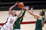 Stanford guard Lexie Hull (12) battles for a rebound against Cal Poly guard Abbey Ellis, center, and Sierra Campisano, right, during the first half of an NCAA college basketball game in Stanford, Calif., Wednesday, Nov. 25, 2020. (AP Photo/Tony Avelar)